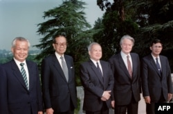 FILE: From left to right : Kieu Samphan, leader of the pro-Chinese Red Khmers, Son Sann, leader of the Nationalist party, Prince Norodom Sihanouk, leader of the Cambodian resistance, Roland Dumas, French Minister of Foreign Affairs, and Hun Sen, Prime Minister of the Phnom Penh government, pose before starting round table talks on July 25, 1989 in La Celle Saint Cloud, France. From July 30 to August 30, 1989, representatives of 18 countries, the four Cambodian parties, and the UN Secretary General met in Paris in an effort to negotiate a comprehensive settlement : withdrawal of the remaining Vietnamese occupation troops and genuine self-determination for the Cambodian people.