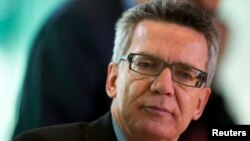FILE - German Interior Minister Thomas de Maiziere says it's imperative to set up uniform state and national guidelines for handling migrants who are deemed potentially dangerous.