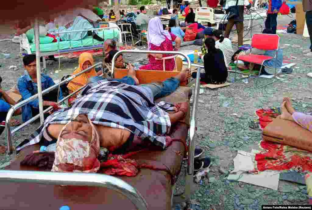 Earthquake survivors rest on beds outside a hospital in Palu, Sulawesi Island, Indonesia, Sept. 29, 2018.