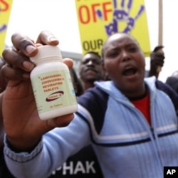 Demonstraters in Nairobi, Kenya on Thursday, Dec. 9, 2010, protest a potential free trade area agreement between the EU and India that could see cheap generic anti-AIDS drugs phased out. (AP Photo/Khalil Senosi)