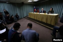 FILE - Taiwanese Minister of Foreign Affairs David Lee (C) speaks at a news conference after Sao Tome ended ties with Taiwan, in Taipei, Dec. 21, 2016.