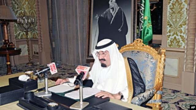 Saudi King Abdullah addresses the nation from his office at the Royal Palace in Riyadh, March 18, 2011