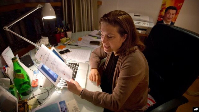 French journalist Ursula Gauthier, a reporter for the French news magazine L'Obs, holds statement from the Chinese Ministry of Foreign Affairs, Beijing, Dec. 26, 2015.