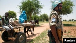 FILE - A UNAMID peacekeeper is seen on patrol in Sudan.