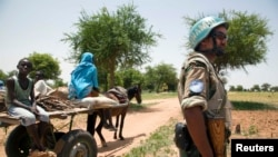 FILE - A UNAMID peacekeeper on patrol in Sudan.