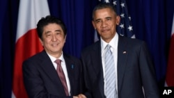 FILE - .S. President Barack Obama, right, and Japan's Prime Minister Shinzo Abe, left, shake hands during a bilateral meeting.