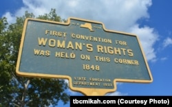 This plaque, in Seneca Falls, New York, marks the site where the women's rights movement was set in motion.