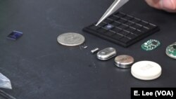 The implants — pictured to the right of the U.S. quarter — use nanochannels to release medication at the molecular level.