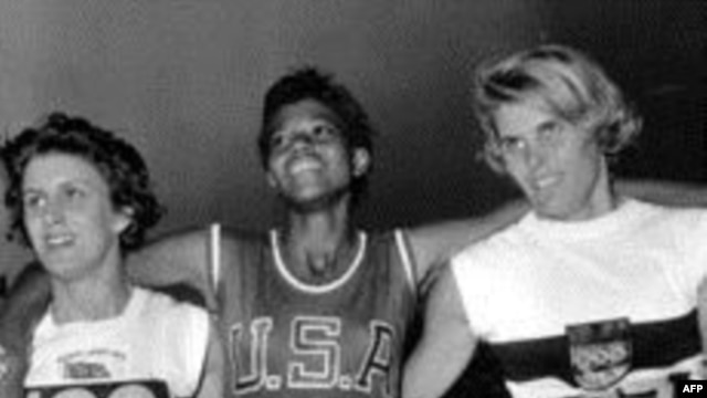 Dorothy Hyman of Great Britain, Wilma Rudolph of the U.S. and J. Heine of West Germany pose after the 200 meter race at the XVI Summer Olympic Games in Rome