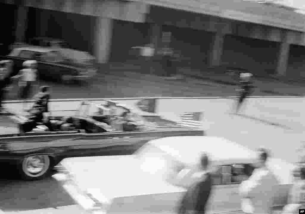 President John F. Kennedy's limousine speeds along Elm Street toward the Stemmons Freeway overpass moments after he was shot at Dealey Plaza in Dallas, Texas, Nov. 22, 1963.