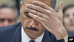 Attorney General Eric Holder testifies before the House Oversight and Government Reform Committee hearing entitled 'Fast & Furious: Management Failures at the Department of Justice,' on Capitol Hill in Washington, February 2, 2012.