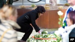 Nidhi Chaphekar, Jet Airways flight attendant and a victim of the Brussels airport terror attack, lays a rose on a memorial in Brussels, March 22, 2017. Belgian leaders, victims and families of those who died in the suicide bomb attacks on the Brussels airport and subway are marking the first anniversary of the attacks, which killed 32 people and wounded more than 300 others.