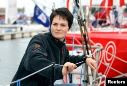 FILE - Now-retired English sailor Ellen MacArthur stands at the start point of the Route du Rhum in Brittany, Oct. 27, 2006.
