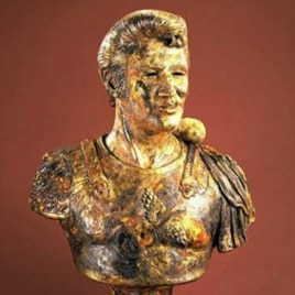 This ceramic bust by Robert Arneson features a rock on Elvis' shoulder, a reference to the entertainer's status as the ''King of Rock'.