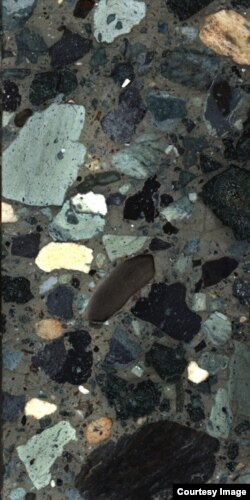 A portion of the drilled cores from the rocks that filled the crater. Scientists found melted and broken rocks such as sandstone, limestone and granite. This finding suggests that the impact vaporized these rocks forming sulfate aerosols in the atmosphere