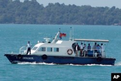 A speed boat transports samples from some passengers who have reported stomachaches or fever, in the Westerdam anchored off Sihanoukville, Cambodia, Thursday, Feb. 13, 2020.