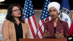 In this July 15, 2019, file photo, U.S. Rep. Ilhan Omar, right, speaks, as U.S. Rep. Rashida Tlaib listens, during a news conference at the Capitol in Washington, D.C. (AP Photo/J. Scott Applewhite, File)