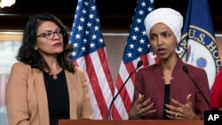 FILE - In this July 15, 2019, file photo, U.S. Rep. Ilhan Omar, D-Minn, right, speaks, as U.S. Rep. Rashida Tlaib, D-Mich. listens, during a news conference at the Capitol in Washington.(AP Photo/J. Scott Applewhite, File)