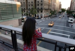 FILE - Sameena, 22, a member of the Indian Dawoodi Bohra community, overlooks Amsterdam Avenue. from a bridge in New York, July 12, 2016. While living her dream of being a graduate student at an Ivy League school in America, Sameena is also coming to terms with the knowledge that she was circumcised at 7. At least 200 million girls and women alive today have undergone some form of female genital cutting, according to the United Nations.