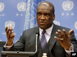 FILE - John Ashe, Antigua and Barbuda's former U.N. ambassador, speaks during a news conference at U.N. headquarters, Sept. 17, 2013.