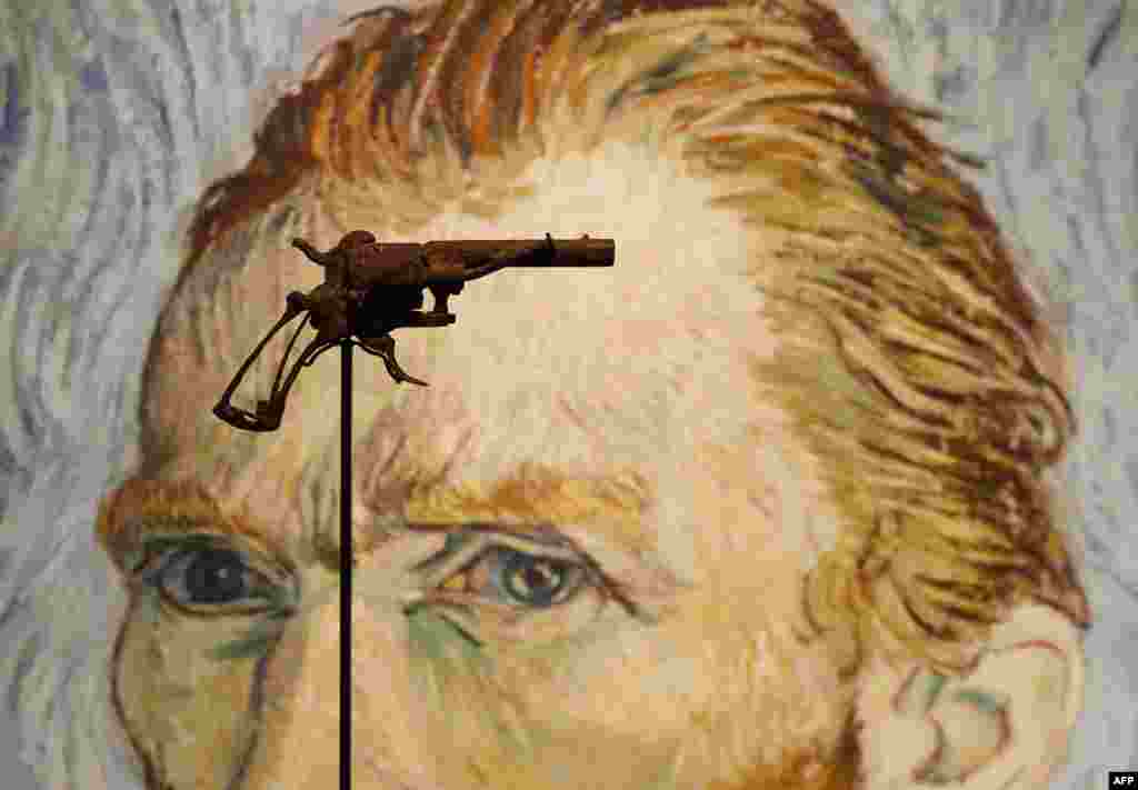 A revolver believed to be the gun Dutch 19th century painter Vincent Van Gogh would have used to kill himself on 27 July 1890 is on public display on June 14, 2019 at Paris' Drouot auction house  before it goes under the hammer later today.