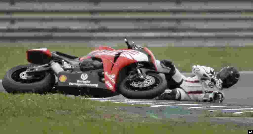 Michael Schumacher crashes with his Honda CBR 1000RR during the second run of the Superbike International German Championship in Oschersleben, May 18, 2008.