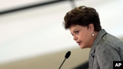 Brazil's President Dilma Rousseff delivers a speech in Brasilia, August 8, 2011