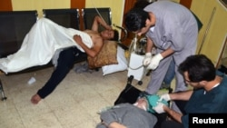 People, affected by what activists say is nerve gas, are treated at a hospital in the Duma neighborhood of Damascus August 21, 2013.