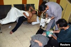 People, affected by what activists say is nerve gas, are treated at a hospital in the Duma neighborhood of Damascus, Aug. 21, 2013.