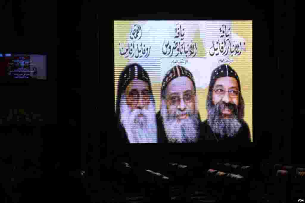 The three final candidates for pope are projected on a TV screen at Saint Mark's Coptic Orthodox Cathedral in Cairo, November 4, 2012. (Yuli Weeks/VOA)