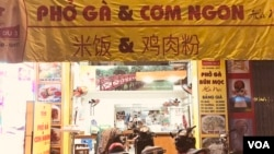 Many Vietnamese shops carry signs in Chinese, a lingering sign of the shared history, though Vietnam and China have taken different turns in the modern economy. (H. Nguyen/VOA)