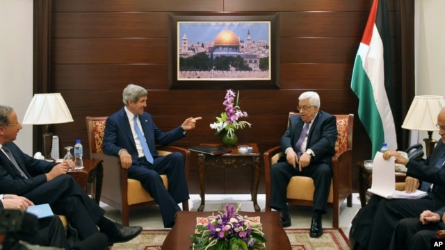 U.S. Secretary of State John Kerry, center left, meets with Palestinian President Mahmoud Abbas, center right, on Friday, July 19, 2013 in the West Bank city of Ramallah.
