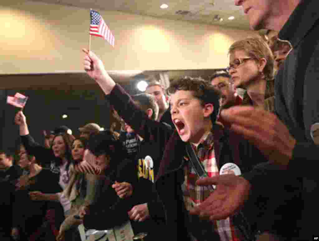 A young supporter of Republican presidential candidate Ron Paul celebrates at Paul's New Hampshire primary night rally in Manchester, New Hampshire, January 10, 2012. (Reuters)