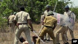 Indian police officers use batons on a villager opposing a government plan to build a nuclear power plant in Jaitapur, Maharashtra state, India, April 19, 2011