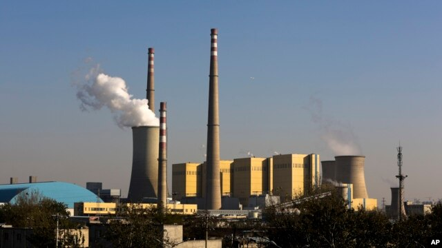 FILE - Smoke billows from a coal-fired power plant. The Supreme Court issued an order Tuesday saying new guidelines on carbon emissions must be suspended until legal challenges are resolved.