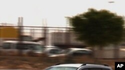 A vehicle sporting an Egyptian diplomatic number plate, is seen driving away from the Sallum border crossing with Libya into Egypt on May 21, 2011.