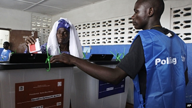 Ma-Fanta Konneh, 60, casts her vote for president at a polling station in Kendeja Community School in Monrovia, Liberia, October 11, 2011.