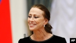 FILE - Russian ballet dancer Maya Plisetskaya smiles at a presentation ceremony of state awards in the Kremlin in Moscow, Russia, Oct. 31, 2011.