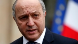 French Minister of Foreign Affairs Laurent Fabius leaves after the weekly cabinet meeting at the Elysee Palace in Paris, Feb. 19, 2014.