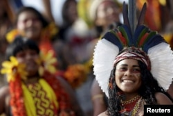 An indigenous woman from Pataxo tribe poses for photos after participating in a parade of indigenous beauty during the first World Games for Indigenous Peoples in Palmas, Brazil, Oct. 29, 2015.