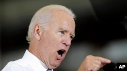 FILE - Vice President Joe Biden speaking during a visit at Portsmouth Naval Shipyard in Kittery, Maine, Sept. 3, 2014.