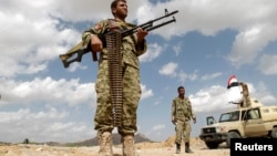 FILE - Army soldiers man a checkpoint in al-Mahfad, in the southern Yemeni province of Abyan, May 23, 2014. An attack by an unmanned aircraft on a car in southern Yemen overnight killed four suspected al Qaida militants.
