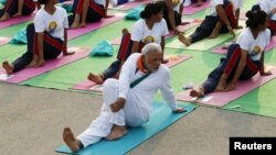India's Prime Minister Narendra Modi participates in a yoga session to mark International Day of Yoga, in New Delhi, India, June 21, 2015. Modi led tens of thousands of people in the yoga session in the centre of the capital on Sunday to showcase the country's signature cultural export, which has prompted criticism of fomenting social divisions at home.