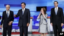 U.S. Republican presidential candidates Ron Paul (L), Mitt Romney (2nd L), Michele Bachmann and Tim Pawlenty (R) gather before the start of their debate in Ames, Iowa August 11, 2011