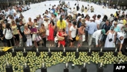 Survivors and relatives of the victims of the 2002 Bali bombings attend a ceremony marking the 10th anniversary of the Bali attacks at the Garuda Wisnu Kencana cultural park in Jimbaran located in Indonesia's resort island of Bali, October 12, 2012.
