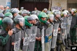FILE - Cambodian riot policemen line up as supporters of opposition parties gather for demonstrations in Phnom Penh, Cambodia, Sept. 15, 2013.
