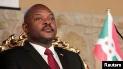 FILE - Burundi's President Pierre Nkurunziza attends the opening of a coffee conference in the capital, Bujumbura, Feb. 13, 2014.