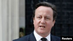 British Prime Minister David Cameron moved to end a revolt over European Union membership in his ruling Conservative party saying all his ministers backed his strategy on the issue despite two expressing more sceptical views than his own, (File photo).