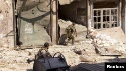 叙利亚政府军9月23日在阿勒颇一个街区