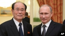 FILE - In this Feb. 7, 2014, photo, Russian President Vladimir Putin, right, shakes hands with president of the Presidium of North Korea's Supreme People's Assembly Kim Yong Nam at the Olympic reception hosted by the Russian President in Sochi, Russia.